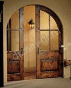 Арочная раздвижная дверь из массива сосны